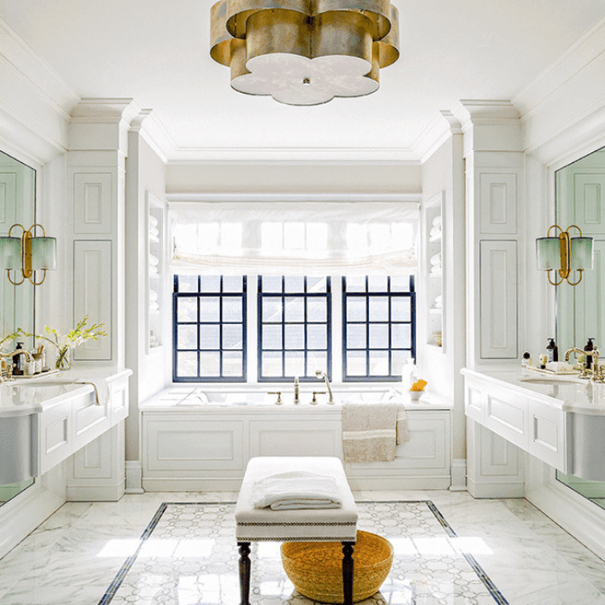spacious bathroom with hanging brass light fixture