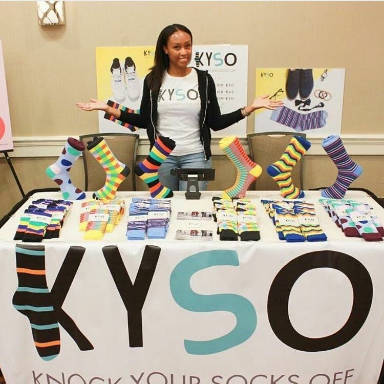 Marisa Walcott displaying Kyso socks at a pop up event