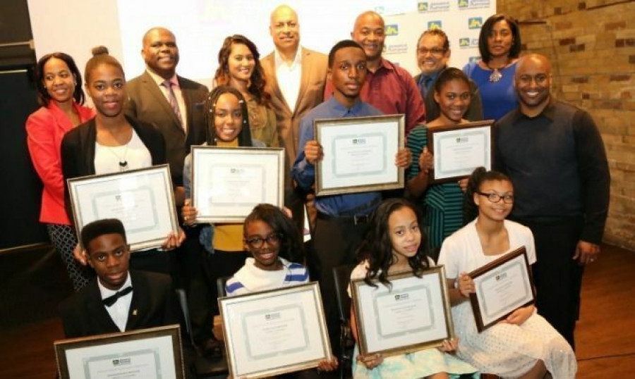The winners and sponsors of the Jamaica National Building Society Black History Month Essay Competition
