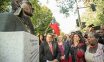 Montreal Mayor Denis Coderre looks on with artist Dominique Dennery (in red) as the bust is unveiled.